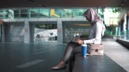 Asian casual business people on the go using laptop outside