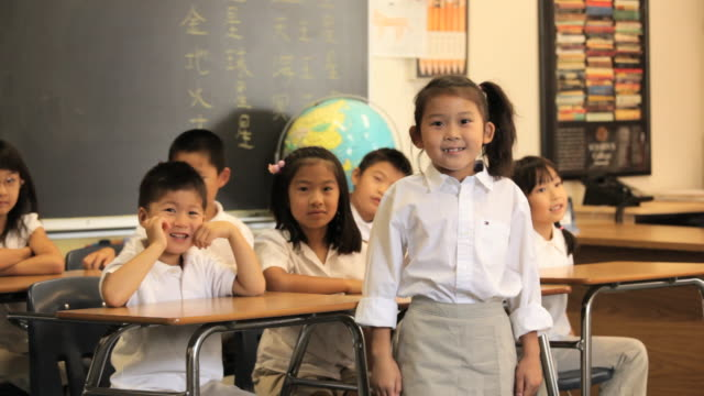 asian child in classroom presenting model solar system to camera / richmond, virginia, usa - explaining stock videos & royalty-free footage