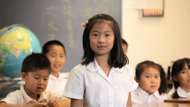 Asian Child in Classroom Talking to Camera / Richmond, Virginia, USA