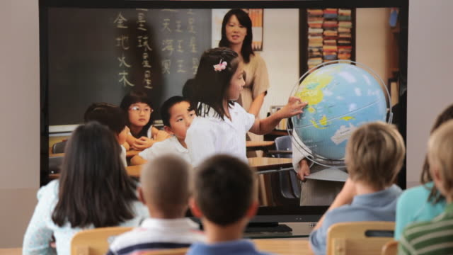 ms asian child in classroom talking to camera / richmond, virginia, usa - non western script stock videos & royalty-free footage