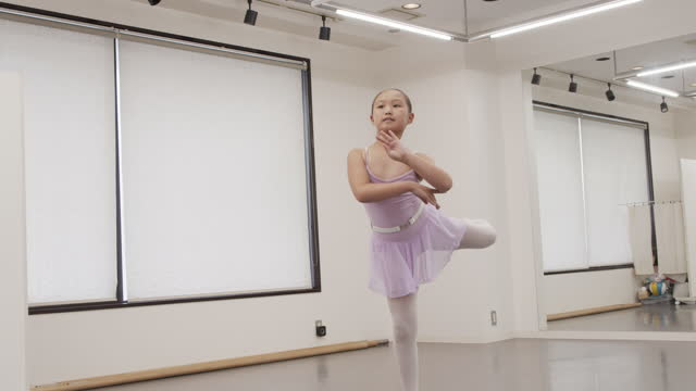 asian child of a ballet students in leotard taking pose in studio. - leotard stock videos & royalty-free footage