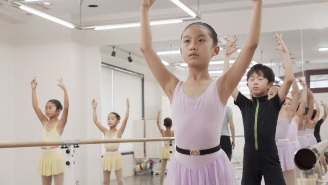 asian children ballet students taking lesson in studio with ballet lesson bar. - leotard stock videos & royalty-free footage