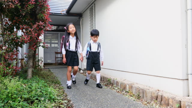 asian children leaving home to walk to school - japanese school uniform stock videos & royalty-free footage