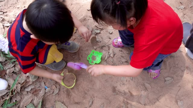 asian children playing sand - sand pit stock videos and b-roll footage