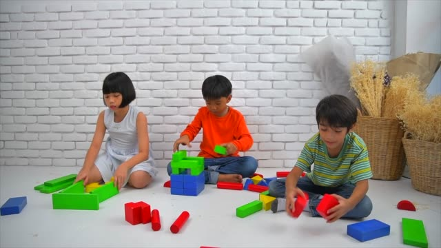 asian Children playing with blocks