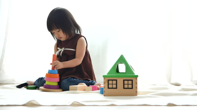 asian children playing with toy block - nursery school building stock videos and b-roll footage