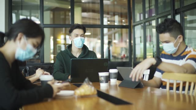 asian chinese at cafe enjoying food and chill out weekend with new normal wearing face mask - resting stock videos & royalty-free footage