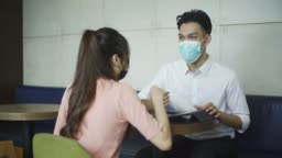 asian chinese at cafe enjoying food and chill out weekend with new normal wearing face mask