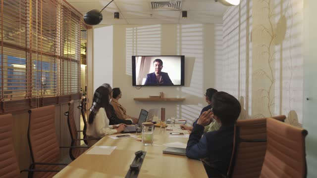 asian chinese business meeting in conference room with television screen presentation - chairperson stock videos & royalty-free footage