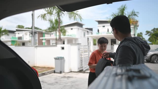 asian chinese couple getting ready loading luggage in their suv going for vacation - luggage stock videos & royalty-free footage