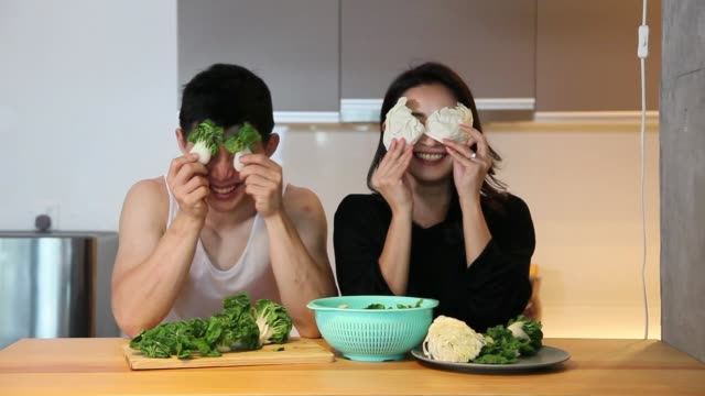 asian chinese couple preparing food in the kitchen - girlfriend stock videos & royalty-free footage