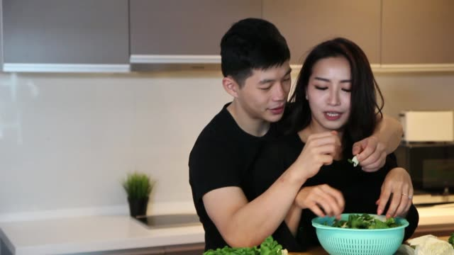 asian chinese couple preparing food in the kitchen - tan stock videos and b-roll footage