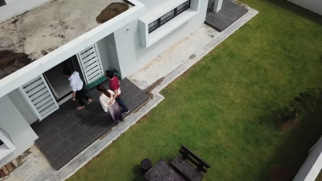 asian chinese couple receiving house keys from real estate agent outside new house - computer key stock videos & royalty-free footage