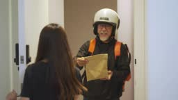asian chinese delivery man with helmet  press door bell for grocery food delivery