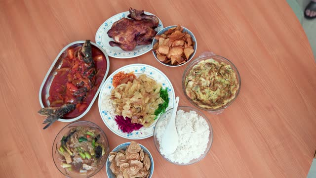 asian chinese family arranging preparing family reunion dinner for chinese new year eve - malaysian culture stock videos & royalty-free footage