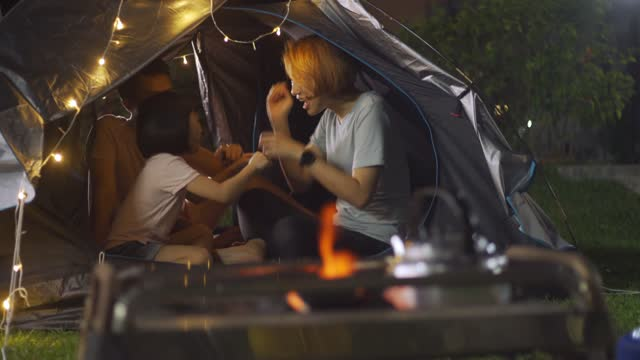 asian chinese family camping at backyard of their house staycation weekend activities - active lifestyle stock videos & royalty-free footage