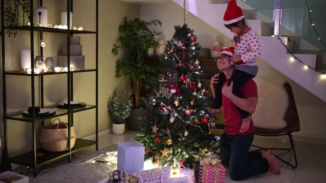 asian chinese family father daughter decorating christmas tree at home getting ready for christmas celebration bonding - decoration stock videos & royalty-free footage