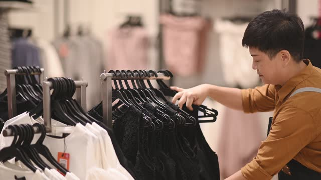 asian chinese female boutique shop clothing store owner working hanging clothes - clothes shop stock videos & royalty-free footage