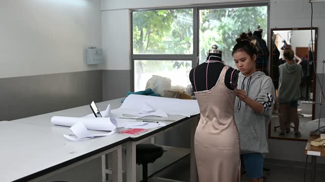 asian chinese female fashion college student measuring and working clothing project at college workshop - measuring stock videos & royalty-free footage