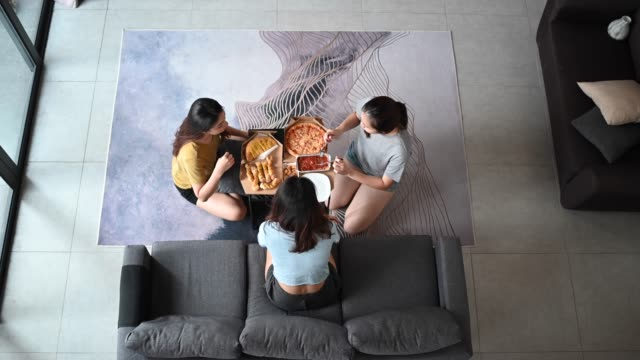 3 asian chinese female friends having pizza for lunch in their living room bonding time - box container stock videos & royalty-free footage