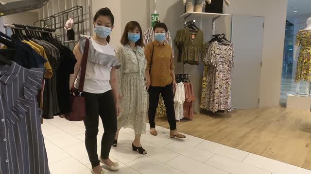 3 asian chinese female friends shopping at clothing store for clothes with shopping bags and face mask - east asian ethnicity stock videos & royalty-free footage