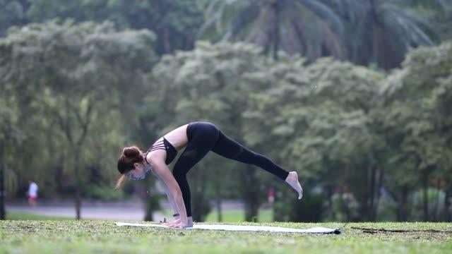 asian chinese female performing yoga pose Cobra pose or Bhujangasana