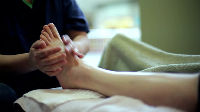 vídeos y material grabado en eventos de stock de asian chinese foot massage health treatment - planta del pie