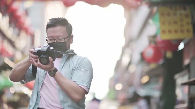 asian chinese male with physical disability on wheelchair photographing in china town sitting on his wheelchair - accessibility stock videos & royalty-free footage
