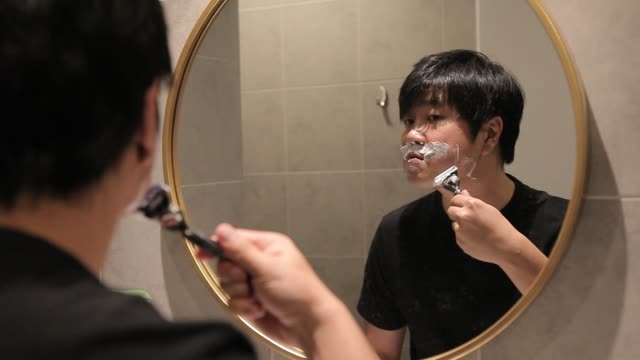 asian chinese man shaving at home - shaving stock videos & royalty-free footage