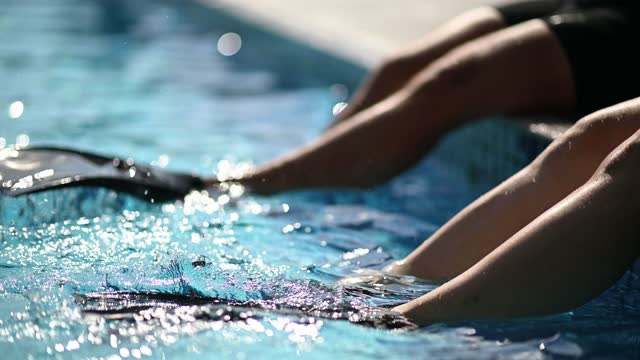 asian chinese mature female adult excited learning legs movement at pool side with the diving flipper guidance from male instructor for diving snorkeling movement at poolside - diving flipper stock videos & royalty-free footage