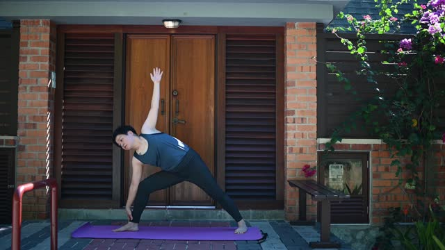 asian chinese mid adult woman practicing yoga during staycation vacation at rural luxury hill resort in the morning - only mid adult women stock videos & royalty-free footage