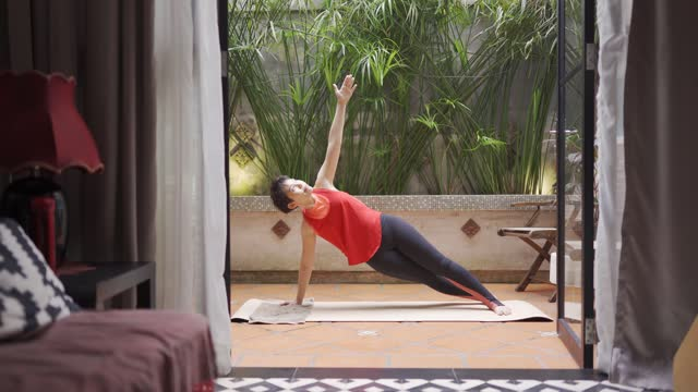 asian chinese mid adult woman workout at home relaxation exercise during weekend leisure time backyard - exercise mat stock videos & royalty-free footage