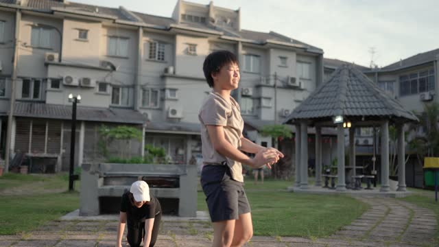 asian chinese mother and son workout together at backyard outdoor. - focus concept stock videos & royalty-free footage
