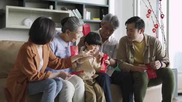 asian chinese multi-generation family celebrating chinese new year at home - celebratory event stock videos & royalty-free footage