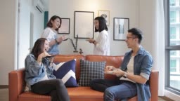 asian chinese roommates having pizza and chatting at home