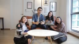 asian chinese roommates playing games and having fun at licing room