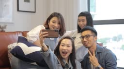 asian chinese roommates taking selfies at home