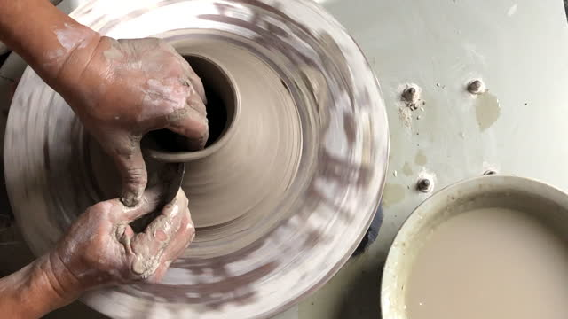 asian chinese senior man clay artist making pottery on a spinning pottery wheel in his craft studio - hobbies stock videos & royalty-free footage