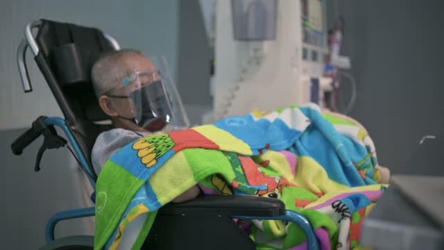 asian chinese senior man in wheelchair with face shield , face mask under dialysis treatment in hospital - human limb stock videos & royalty-free footage