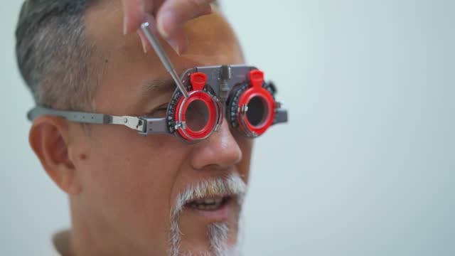 asian chinese senior man patient checking eyesight in ophthalmological clinic - lens optical instrument stock videos & royalty-free footage