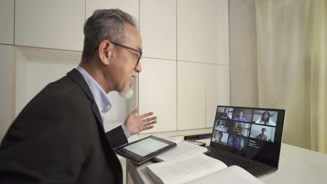 asian chinese senior man professor tutor teacher giving online class to his adults student using laptop work from home - professor stock videos & royalty-free footage