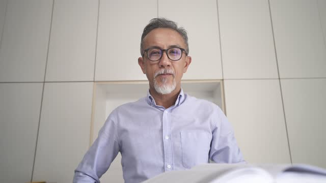 asian chinese senior man professor tutor teacher listening to his adults student using laptop work from home - conference call stock videos & royalty-free footage