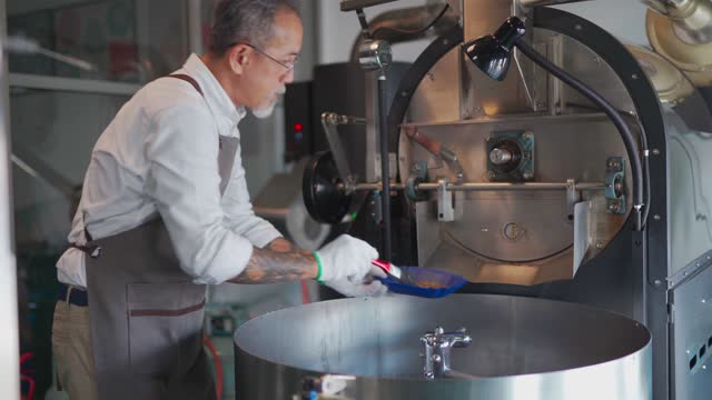 asian chinese working senior man hand with glove brushing and cleaning coffee roaster machine - man and machine stock videos & royalty-free footage