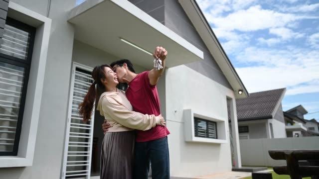 asian chinese young couple just received house key for their new house happy - home ownership stock videos & royalty-free footage