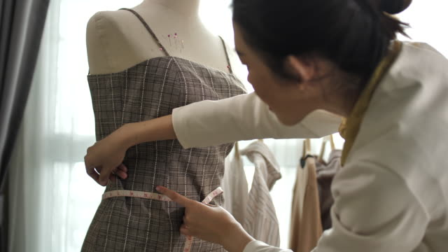 asian clothing designer woman is working with measurements - tailor stock videos & royalty-free footage