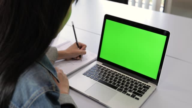 asian college students looking at laptop with green screen - computer monitor stock videos & royalty-free footage