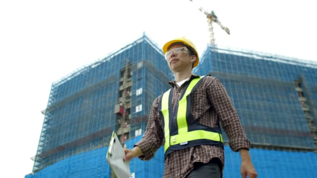 asian construction worker at construction site - hat stock videos & royalty-free footage