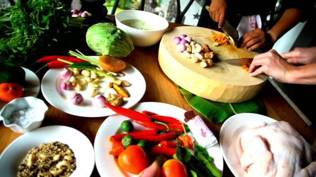 vídeos y material grabado en eventos de stock de asian cooking class cutting with balinese blakas indonesia - colesterol