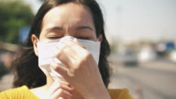 Asian Coughing Sick Girl wearing Air Pollution Mask