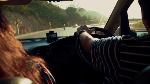 asian couple enjoy the journey - steering wheel stock videos & royalty-free footage